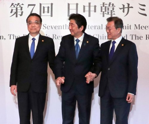 China, Japan, South Korea agree on 'complete denuclearization'