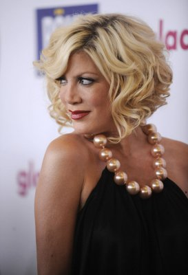 Tori Spelling hospitalized for possible pneumonia