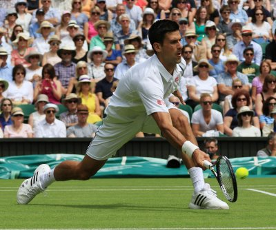 Novak Djokovic wins Wimbledon opener