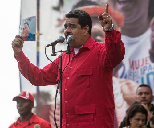 Crowd pelts Venezuela President Maduro with eggs, rocks