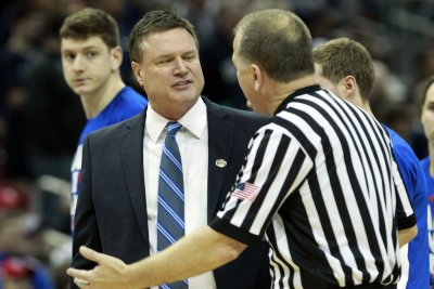 No. 13 Kansas hosts No. 20 WVU in Big 12 clash