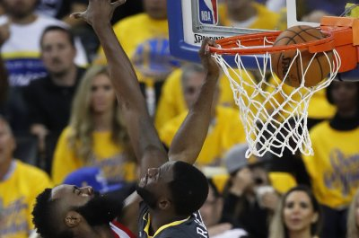 James Harden completes dunk in Draymond Green's face