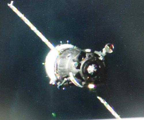 Soyuz rocket docks with International Space Station, delivering three astronauts