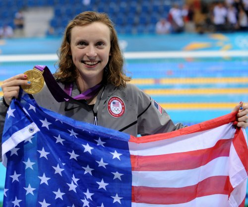 Swimmer Katie Ledecky shatters world record, earns fifth gold