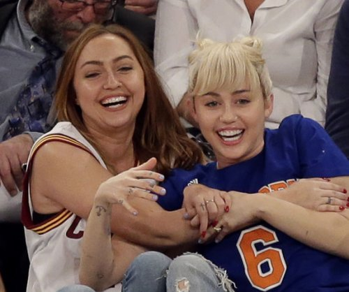 Miley Cyrus wears her engagement ring to Knicks game