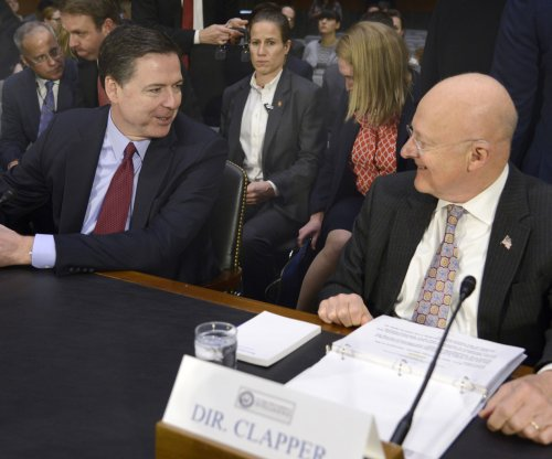 FBI's Comey says GOP also targeted by Russia, but refutes claim of tough cybersecurity