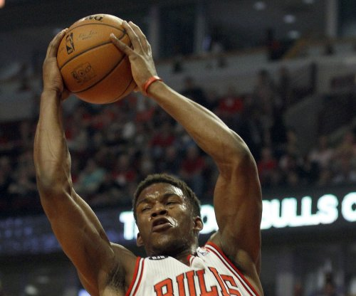 Jimmy Butler, Derrick Rose carry Bulls past Celtics in matinee