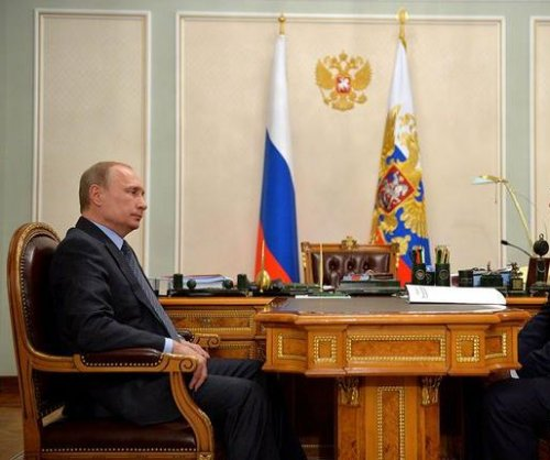 Kremlin releases photos showing Putin at justice meeting