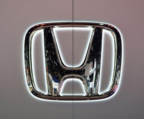 Honda widens Takata airbag recall by 21 million, reports quarterly losses