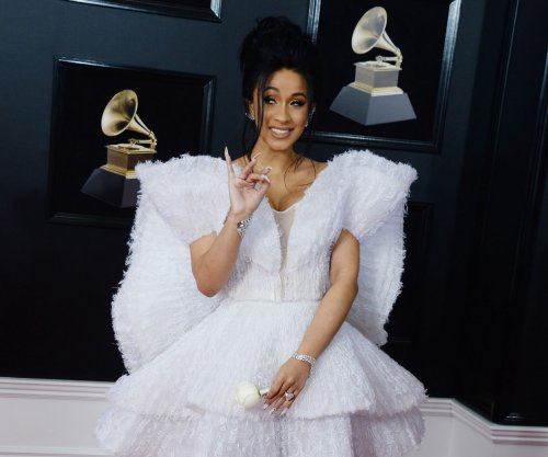 Cardi B shows off baby bump during 'SNL' appearance