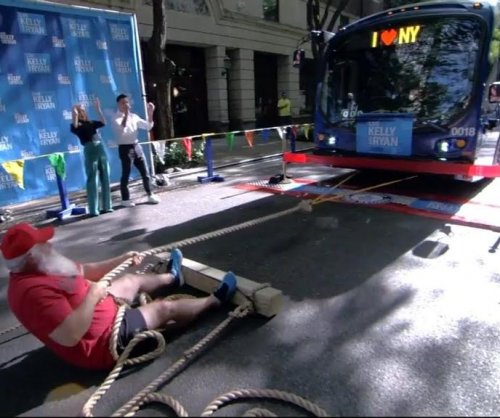 Strongman pulls 33,400-pound bus in New York for Guinness record