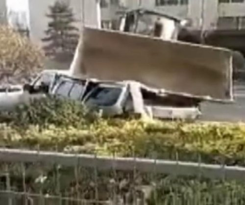 Resident's dispute with property management leads to bulldozer smashing van