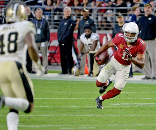 Arizona Cardinals' Larry Fitzgerald not yet committing to NFL return