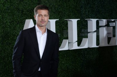 Brad Pitt makes surprise appearance on the Golden Globes stage