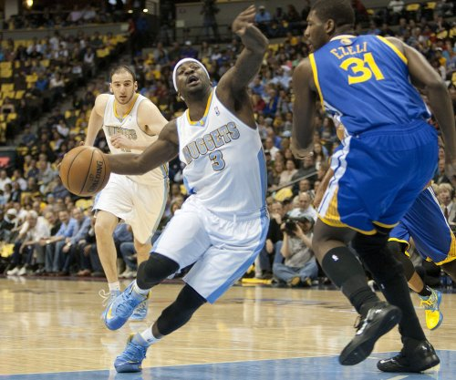 Former Houston Rockets guard Ty Lawson, center Donatas Motiejunas to play in China