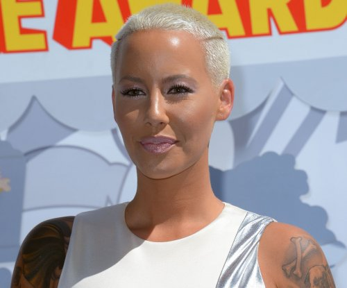 Amber Rose, Wiz Khalifa get close at album listening party after Kanye West feud