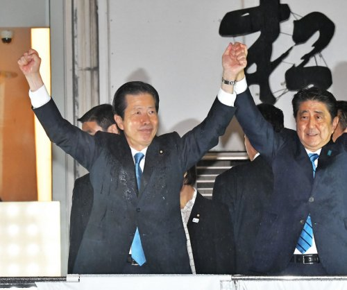Japanese PM Abe dissolves parliament amid new opposition challenge