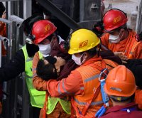 11 rescued from gold mine in China after 2 weeks underground