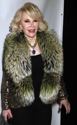 Joan Rivers cuffs self to Costco cart
