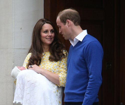 See photos of Prince William and wife Kate Middleton with newborn daughter