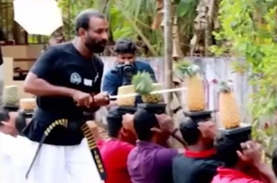 Man slices through 75 pineapples on people's heads in 30 seconds