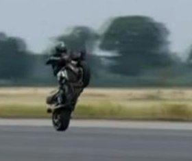 Motorcyclist breaks record with 109 mph handlebar wheelie