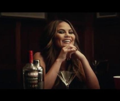 Chrissy Teigen drinks with mom in clip for Smirnoff ad
