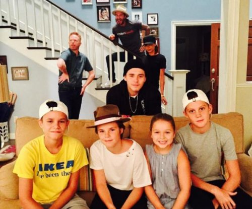 Victoria Beckham and her family visit 'Modern Family' set