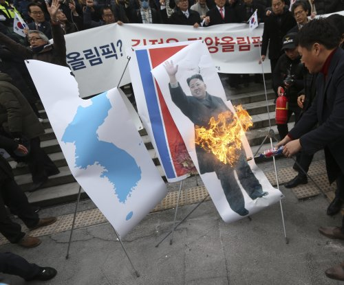 North Korea's Olympic participation sparks criticism and flag-burning in Seoul