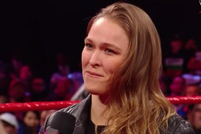 WWE Elimination Chamber: Reigns survives, Rousey slams Triple H