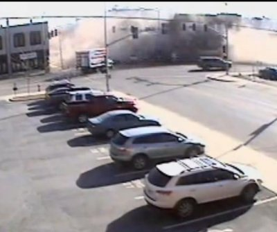 Building corner collapses onto stolen SUV