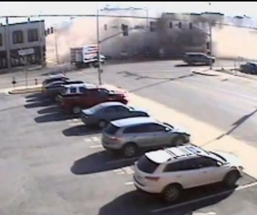 Building corner collapses onto stolen SUV
