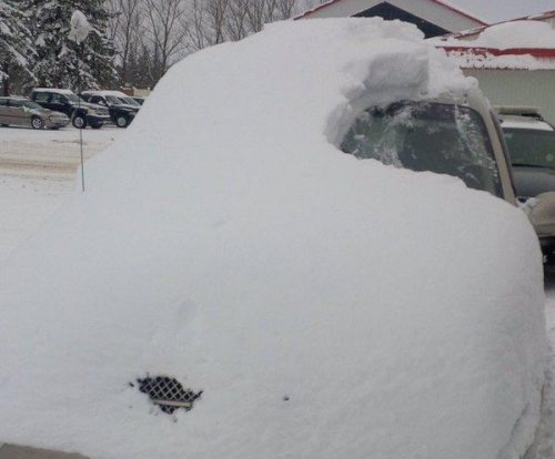 Ontario man ticketed for driving snow-covered car