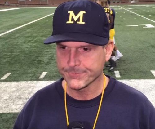 Michigan's Jim Harbaugh criticizes satellite camp ban