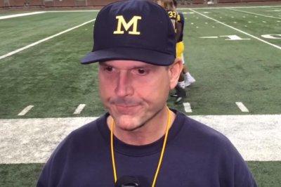 Michigan's Jim Harbaugh criticizes satellite camp ban