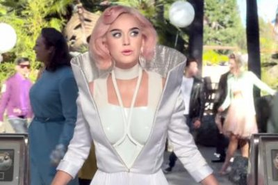 Katy Perry visits a futuristic amusement park in 'Chained to the Rhythm' video