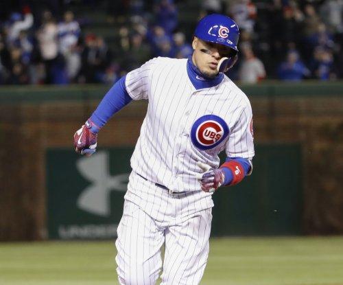 Javier Baez slam helps Chicago Cubs complete sweep of Cincinnati Reds