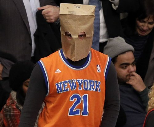 Photos: Fans hide faces behind paper bags as hapless Knicks lose 14th straight game