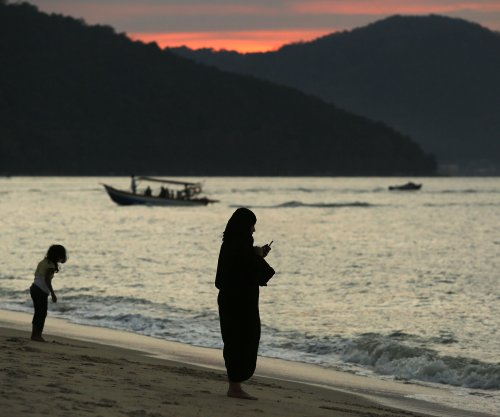 Dredger with Chinese crew capsizes near Malaysia coast
