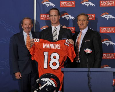 Manning officially a Denver Bronco