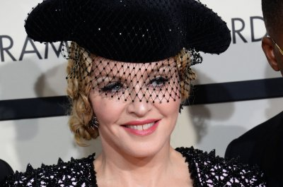 Madonna says she banged her head, suffered whiplash in fall at Brit Awards
