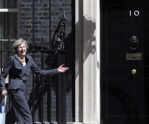 May dismantles Department of Energy and Climate Change
