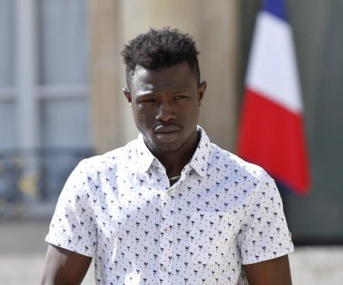Paris 'Spider-Man' granted French citizenship after saving child