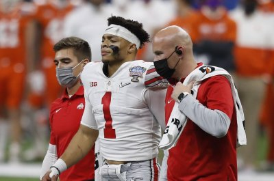 Ohio State coach Ryan Day expects QB Justin Fields to play in CFP title game