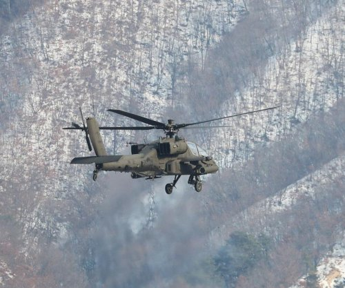 South Korea's Apache helicopters conduct live-shooting drills