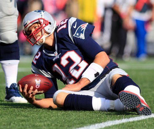 New England Patriots' Tom Brady misses practice with thigh issue