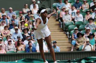 Wimbledon quarterfinals: Venus Williams advances, No. 1 Angelique Kerber ousted