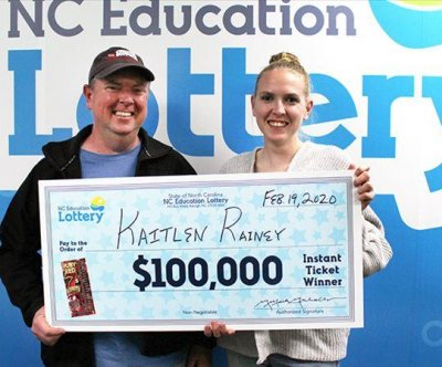 Grandfather's advice leads woman to $100,000 lottery jackpot