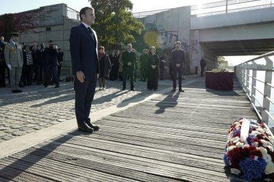 French President Macron attends commemoration for slain Algerian protesters