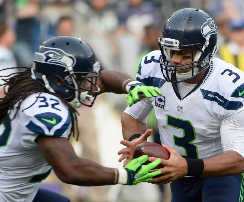 Russell Wilson, Seattle Seahawks stomp Baltimore Ravens, lose RB Thomas Rawls